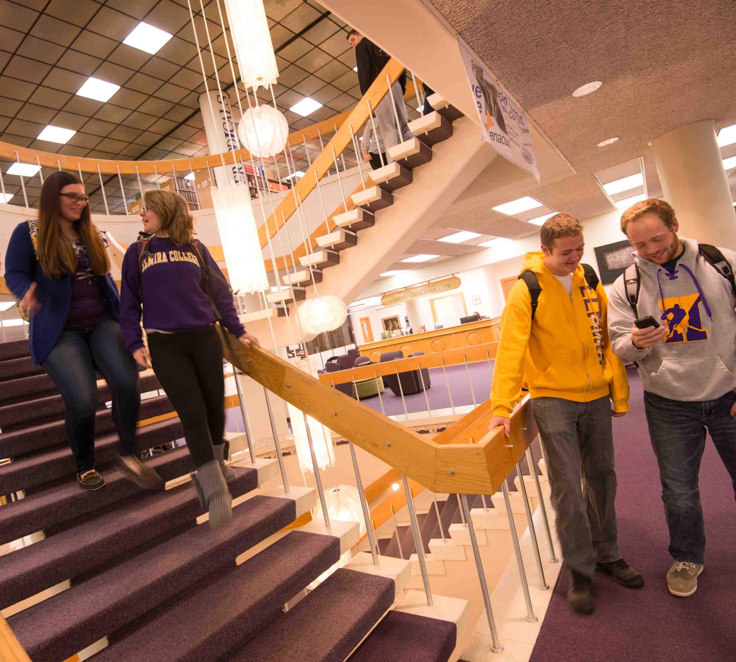 Students coming down stairs in Gannett-Tripp Library